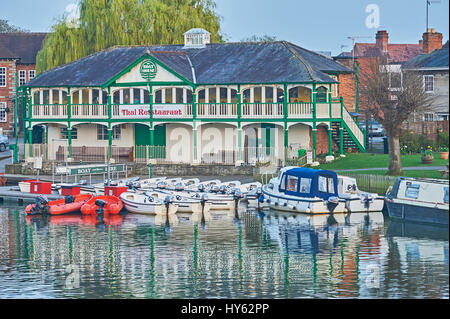 The old boat house and hire boats moored on the River Avon, Stratford upon Avon, Warwickshire. - Stock Image