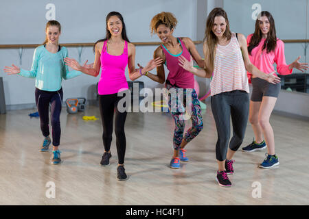 Group of women performing aerobics - Stock Image