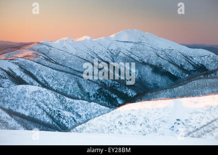Mt Feathertop at sunset during winter near Mt Hotham in Victoria, Australia - Stock Image
