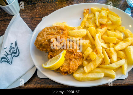 Magpie Cafe battered fish cakes and Chips - Stock Image