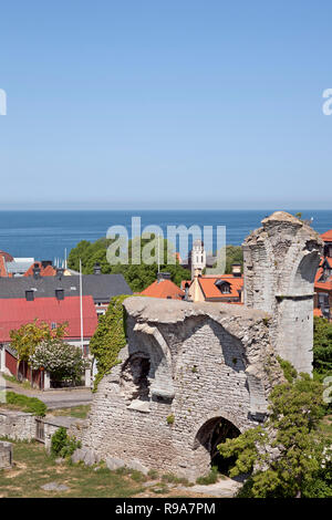 The ruins of the medieval joined churches St Peter and St Hans on a sunny summer's day in Visby on the Swedish island Gotland. View of the Baltic Sea. - Stock Image