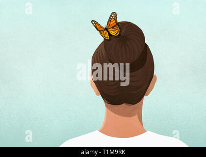 Butterfly in womans hair - Stock Image