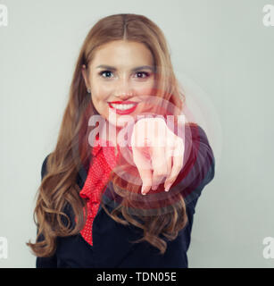 Finger of happy woman pushing a button - Stock Image