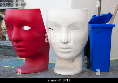Inadvertent tricolour created by two masks and a tidy bin in a street in Sion, Valais / Wallis, Switzerland - Stock Image