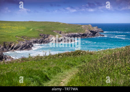 The secluded and rugged coast around Polly Porth Joke in Newquay in Cornwall. - Stock Image