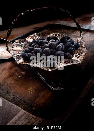 Blueberries on a silver dish - Stock Image