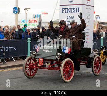 Mr Norman Schwartz, driving his 1902 Rambler, across the finishing line of the 2018 London to Brighton Veteran Car Run - Stock Image