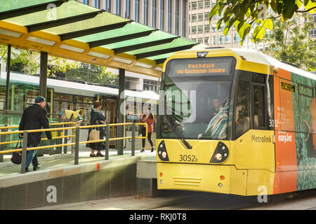 2 November 2018:  Manchester, UK - Metrolink yellow tram in St Peter's Square, at tram stop. - Stock Image