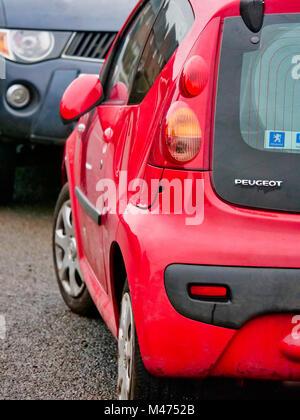 Ashbourne, UK. 14th February, 2018. Cars damaged by the scrum during Ashbourne Royal Shrovetide hugball Football - Stock Image