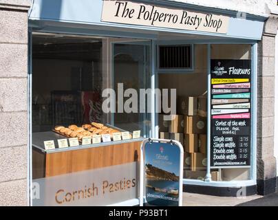 Cornish pasties on display in The Polperro Pasty Shop, Cornwall, England, UK - Stock Image