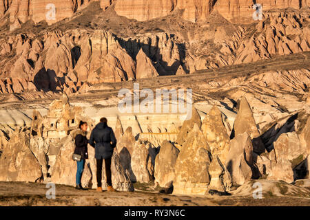Tourist looking at Mount Aktepe near Göreme and the Rock Sites of Cappadocia , Turkey - Stock Image