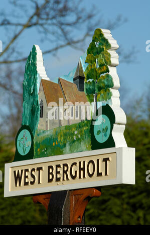 Painted village sign of the church at West Bergholt in Essex. - Stock Image