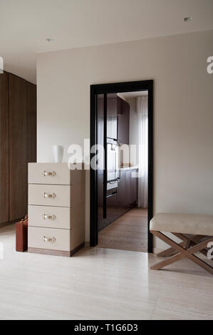 Drawers and bench in hallway by kitchen - Stock Image