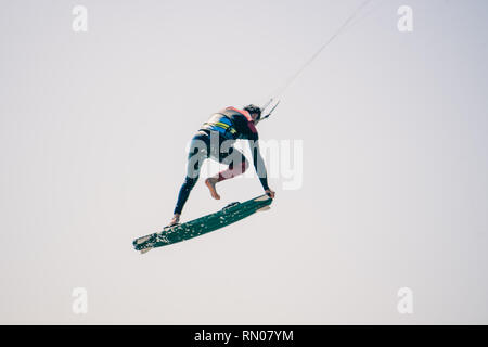 Picture of a Kite surfer performing difficult tricks in high winds. Extrme sports shot in Tarifa, Andalusia, Spain - Stock Image