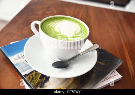 A cup of matcha (green tea) latte - Stock Image