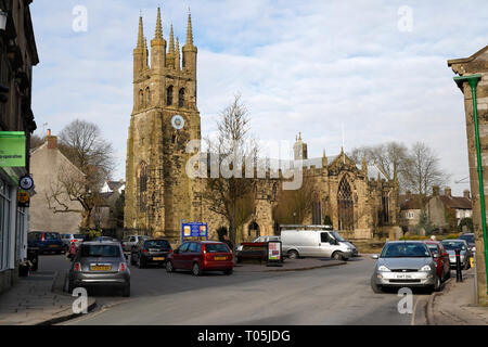 St John the Baptist church, and the village square Tideswell Derbyshire England UK - Stock Image