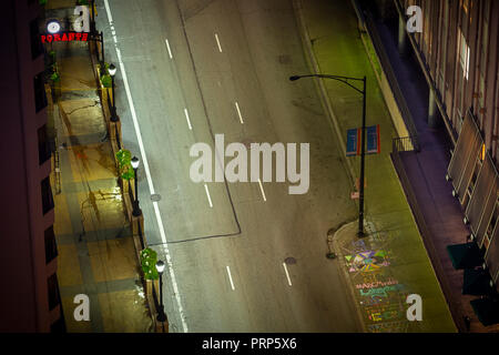 Aerial View Of Cars Streaking By Street Lamp At Night - Stock Image
