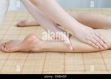 A foot massage the young lady - Stock Image