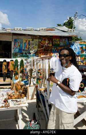 Jamaica Negril beach cool Rastafari man with souvenir shop - Stock Image