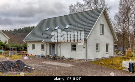 FLODA, SWEDEN - NOVEMBER 21 2018: New built modern typical Swedish white painted detached house - Stock Image