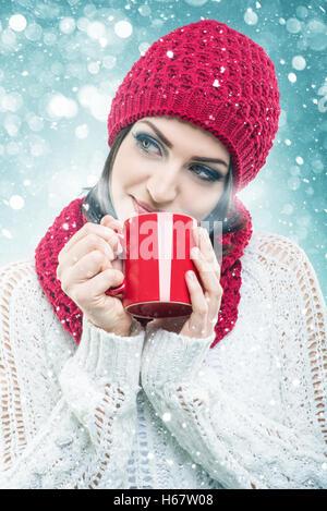 Santa Women, with hot drinks - Stock Image