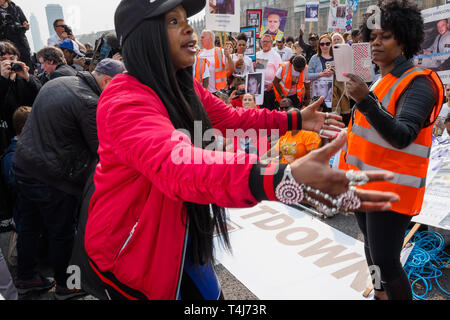 London, UK. 17th April 2019. Knife crime campaigners Operation Shutdown, a consortium of mums, dad's and other bereaved family members and loved ones supported by other campaigners, called for the community to unite and demanded more urgent action by the government to halt the growing epidemic of knife crime. They sit down to block Westminster Bridge and hold a rally there, with a celebrity speaker addresing the crowd. Peter Marshall/Alamy Live News - Stock Image