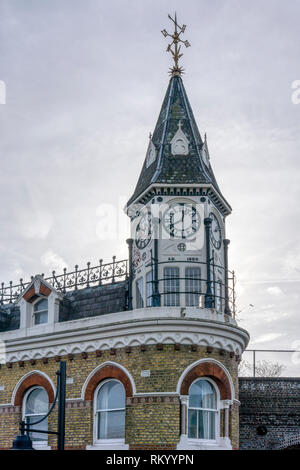 The clock tower on the old Railway Hotel, Brixton, spells out the name around the dial of the clock face.. - Stock Image