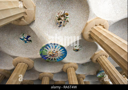 The Hall of Hundred Columns designed by Antoni Gaudi at the Park Güell, Barcelona, Spain - Stock Image