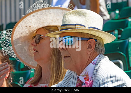 Henley on Thames, Berkshire, UK. 4th July, 2019. Henley Royal Regatta.Spectators viewing the race from the Regatta  Enclosure  with the current race reflecting in the mans sun glasses.  Credit Gary Blake/Alamy Live - Stock Image