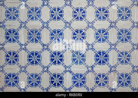 Old Weathered Portuguese Blue Azulejo Ceramic Tiles On An Exterior Wall Of A Building - Stock Image