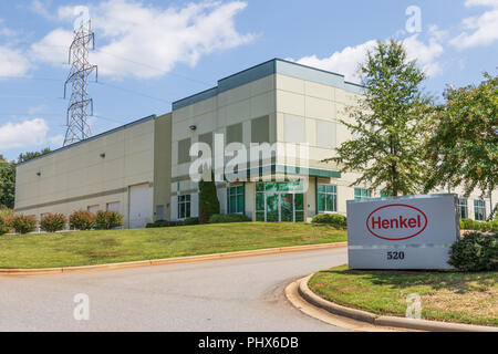 LINCOLNTON, NC, USA-8/25/18: Road sign and warehouse for Henkel Company,  a German chemical and consumer goods company. - Stock Image