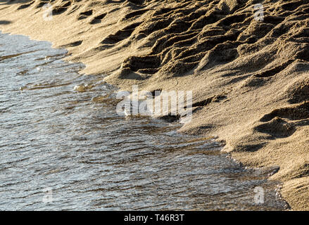 Soft Wave Of Blue Ocean On Sandy Beach. Background. Selective focus - Stock Image
