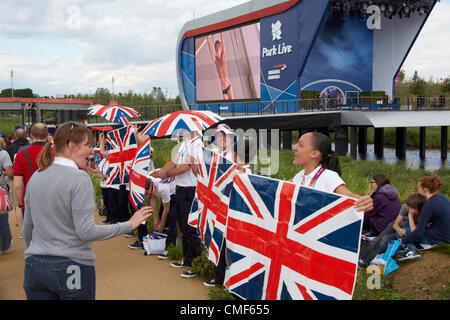 Cheer leaders with giant outdoor screens at Park View West at Olympic Park, London 2012 Olympic Games site, Stratford - Stock Image