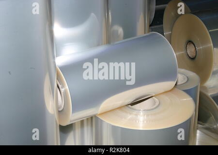 A shot of different sized plastic foil rolls - Stock Image