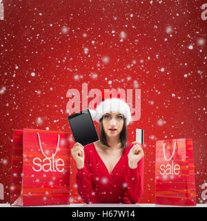 Santa Women with tablet and credit card - Stock Image