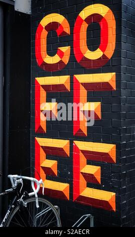 Bright, bold & colourful lettering announces a place for refreshments - a COFFEE bar or lounge. There's nothing quite like subtle shop signage! Photo Credit - © COLIN HOSKINS. - Stock Image