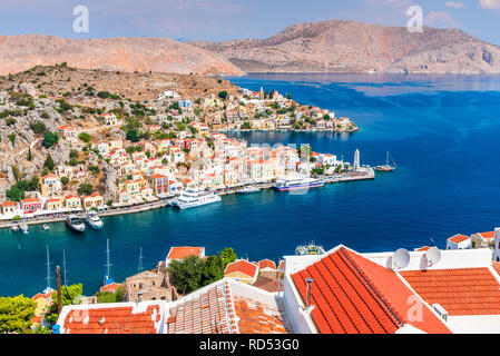 Symi, Greece. Colored houses village in Dodecanese islands, Rhodes. - Stock Image