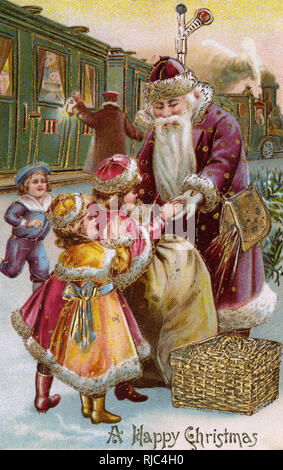 Father Christmas distributing gifts - children on a railway station. - Stock Image