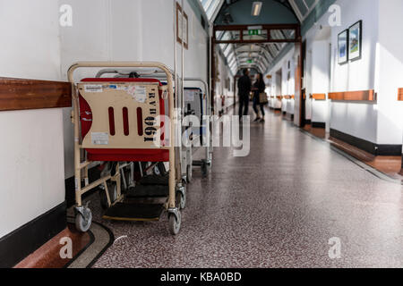 Wheelchairs parked along the corridor at the Royal Victoria Hospital, Belfast - Stock Image