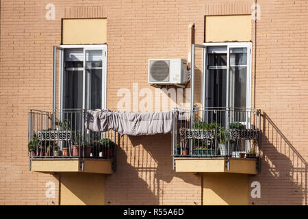 old apartment buildings on a sunny day with a blue sky. Facade of a traditional apartment building . - Stock Image