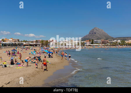 Xabia Spain Playa del Arenal beauitful sandy beach in summer with blue sky and people, also known as Javea - Stock Image