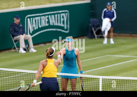 Kristie Ahn (back to camera) shakes hands with Fanny Stollar at the conclusion of her Women's Singles qualifying win at the 2018 Nature Valley Clasic in Birmingham, UK. - Stock Image