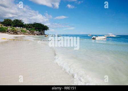 The popular white sand Alona Beach located on Panglao Island, Bohol, Philippines - Stock Image