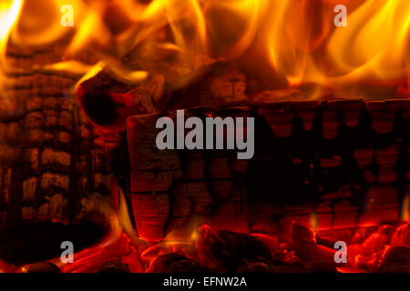Close up of burning logs in a hot fire - Stock Image