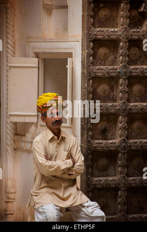 Museum steward in rajasthani turban at Mehrangarh Fort, Jodhpur, Rajasthan, India - Stock Image