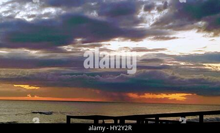 Scenic View Of Dramatic Sky Over Sea - Stock Image