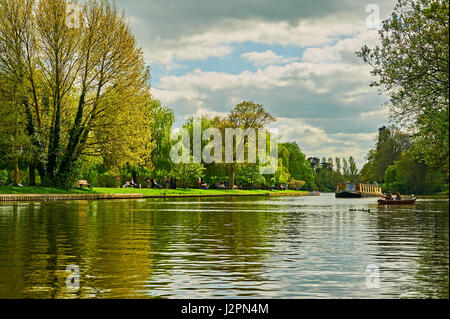 A springtime river scene in Stratford upon Avon, Warwickshire,  with boats on the River Avon. - Stock Image