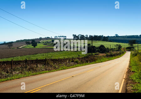 a brazilian countryside road under a blue sky - Stock Image