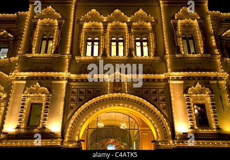 Moscow, Russia; Detail of architecture on the Gum shopping mall at night on Red Square - Stock Image