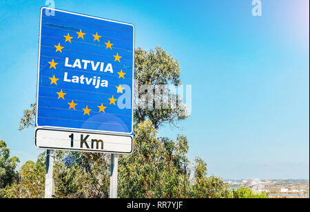Road sign on the border of Latvia as part of an European Union member state. - Stock Image